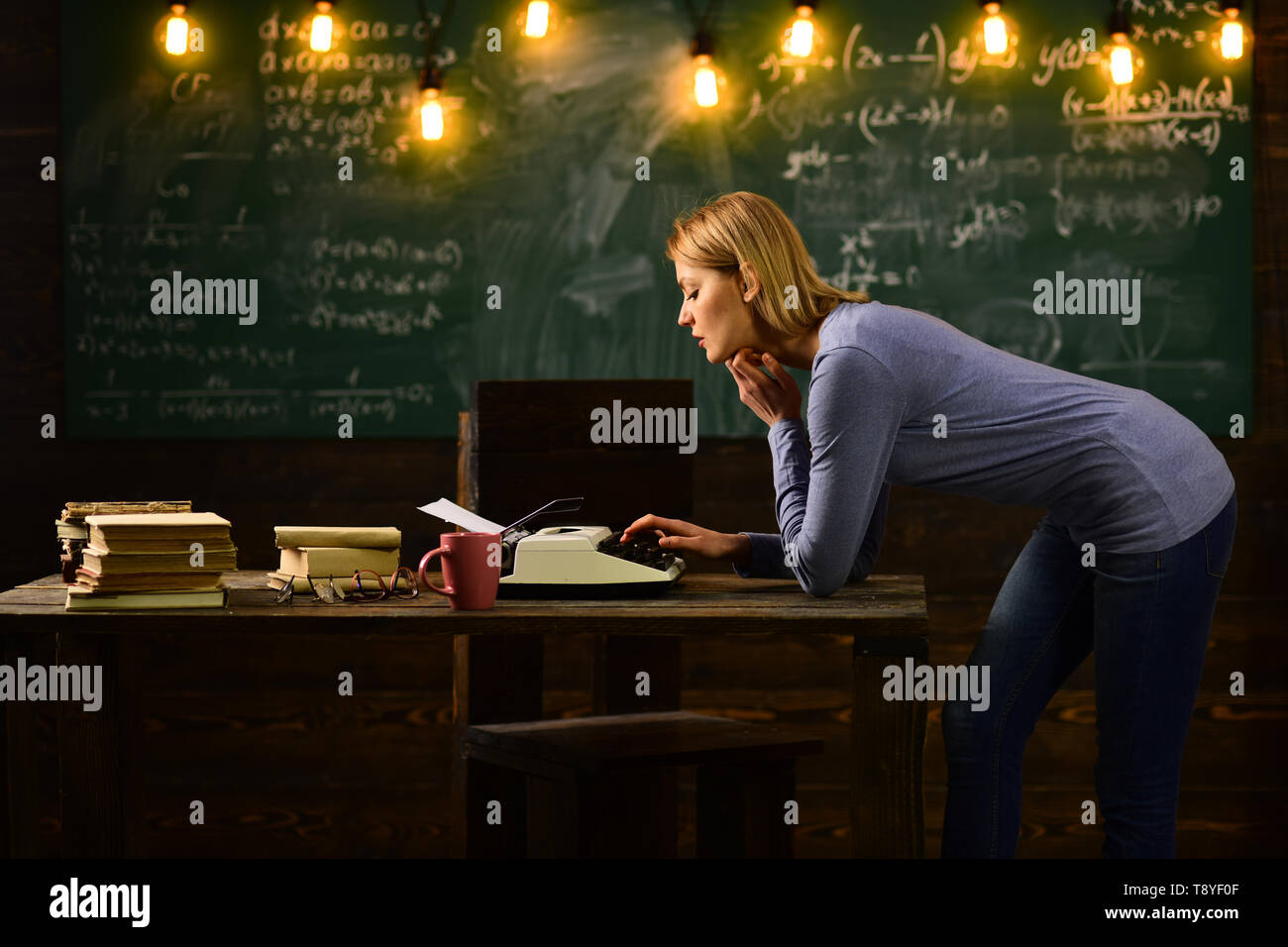 New technology in modern school. Private detective research. Information. Back to school. Thoughtful author. Woman write love story novel in redaction - Stock Image