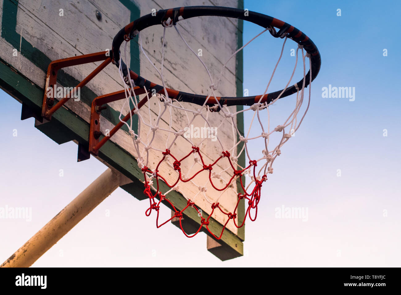 Outdoor basketball court at sunrise nature sky background healthy hobby concept idea background - Stock Image