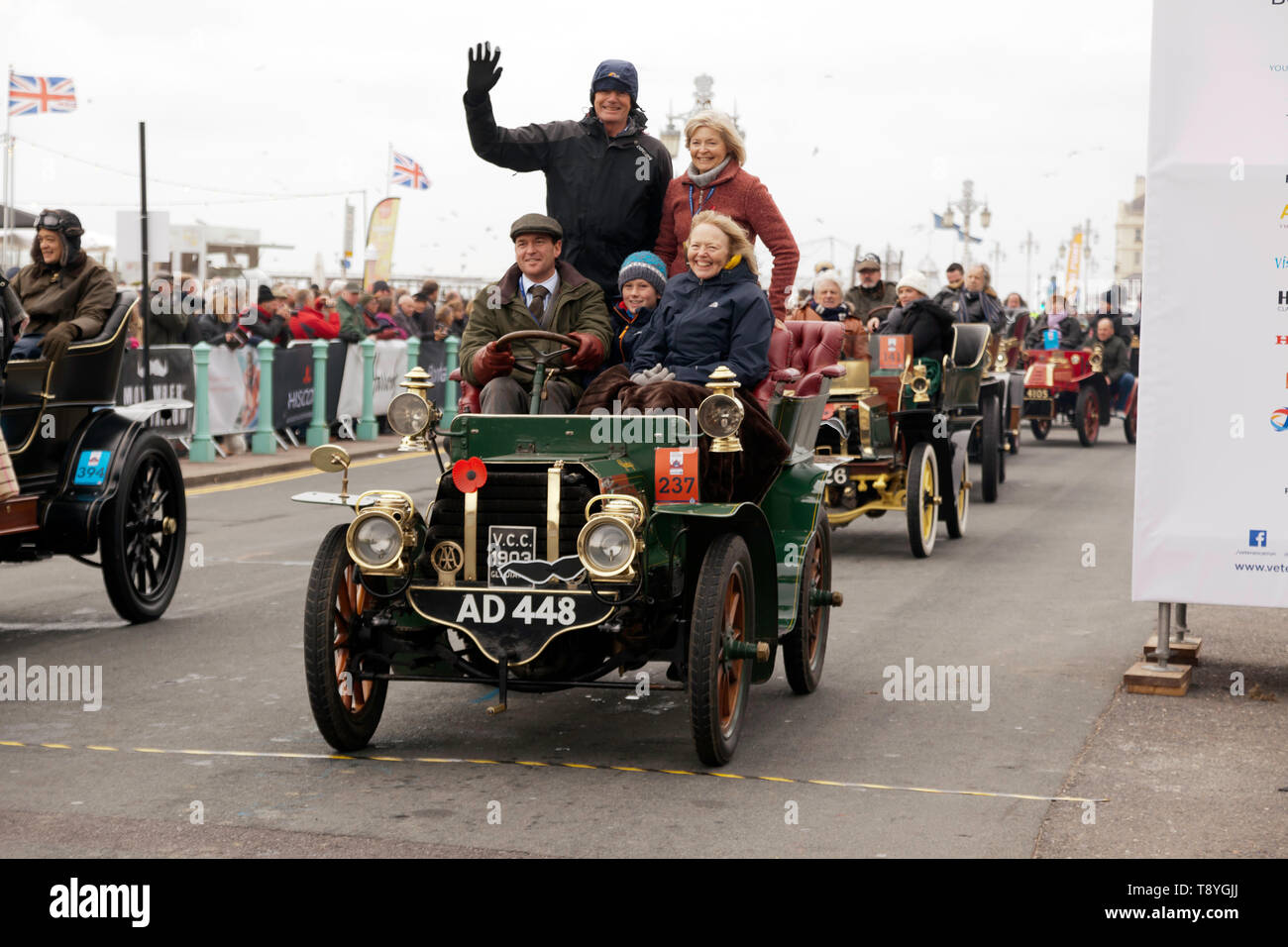 Mr Nigel Timmis driving his 1903 Gladiator across the finishing line at the end of the 2018 London to Brighton Veteran Car Run - Stock Image