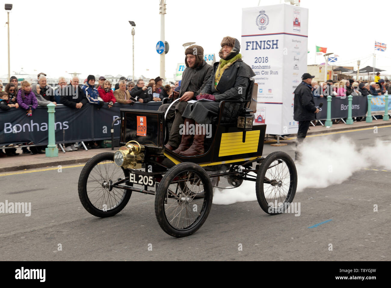 Mr Kempton Moody driving his 1899 Locomobile down Madera drive, after completing the 2018 London to Brighton Veteran Car Run - Stock Image