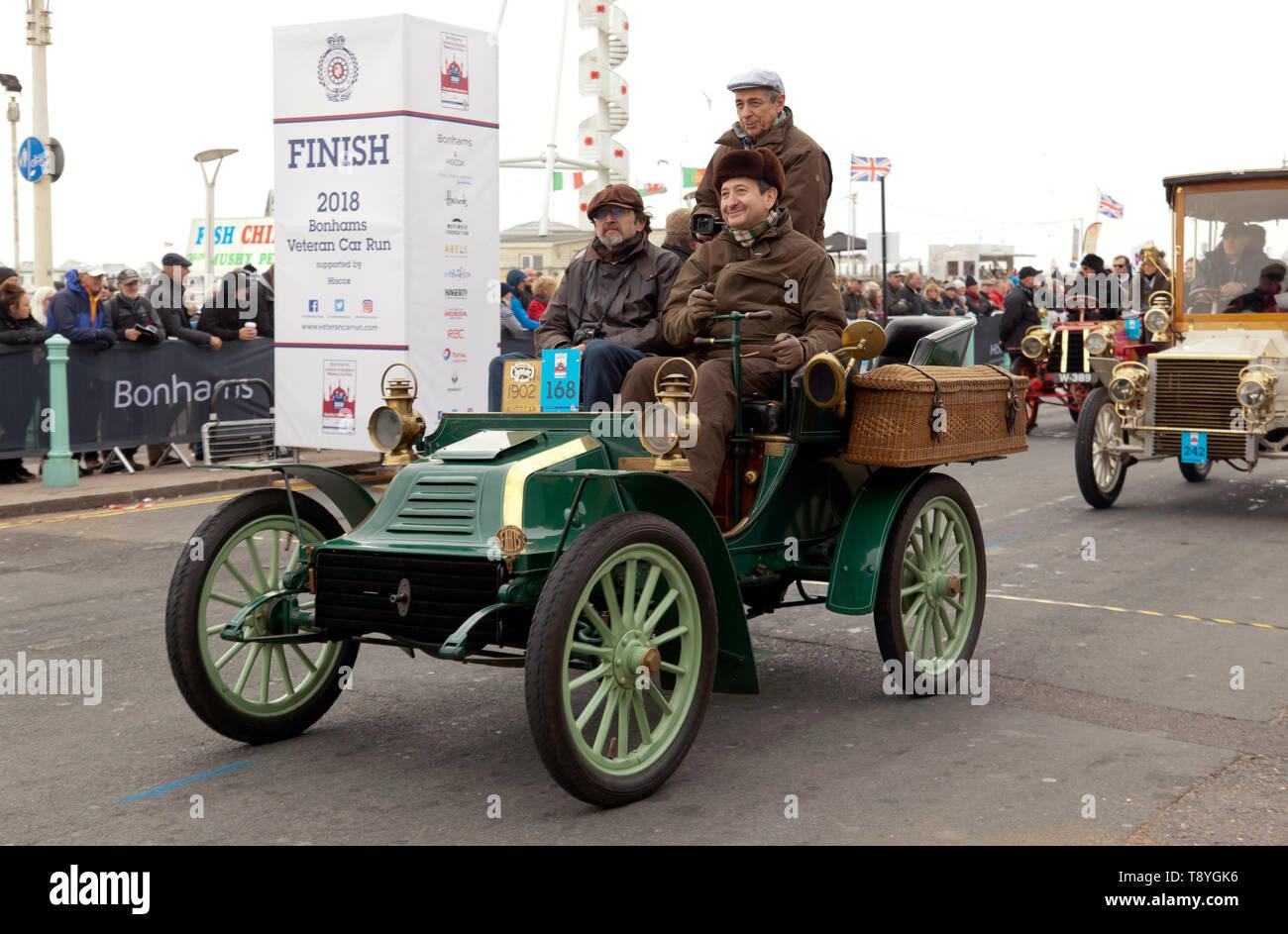Mr Jiri Horice driving his 1902 Autocar across the finishing line of the 2018 London to Brighton Veteran Car Run - Stock Image