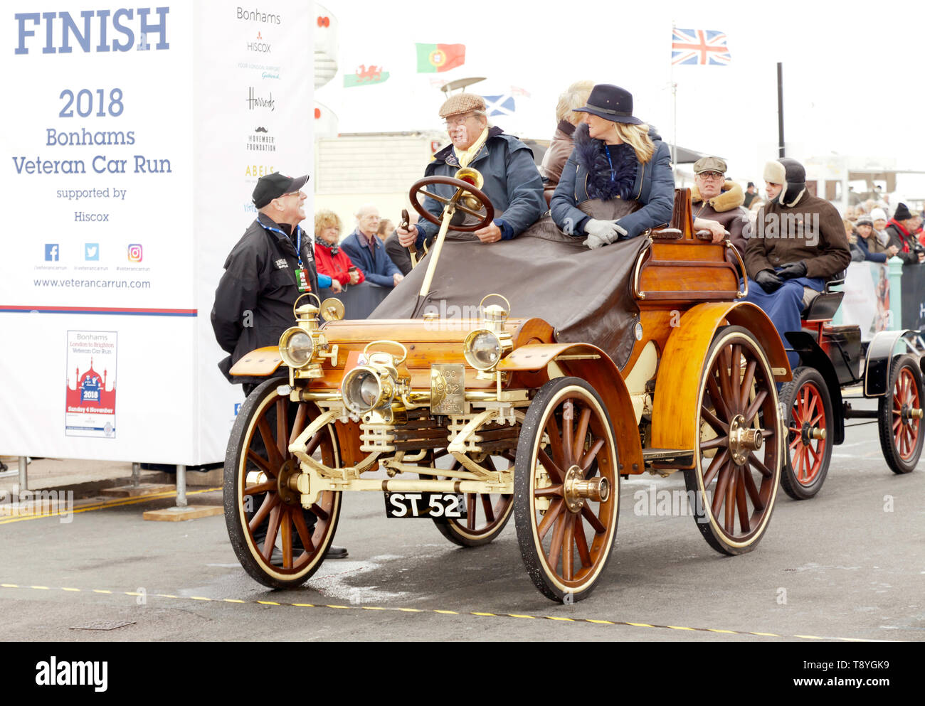Mr Alistair Hacking,  driving a 1902 Arrol-Johnston at the Finish of the 2018 London to Brighton Veteran Car Run - Stock Image