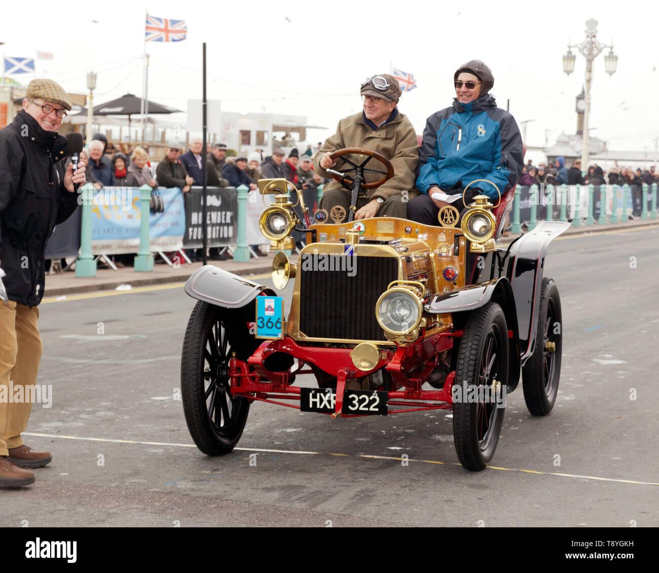 Evert  Louwman  driving 'Genevieve', a 1904 Darracq, across the finishing line of the 2018 London to Brighton Veteran Car Run. - Stock Image