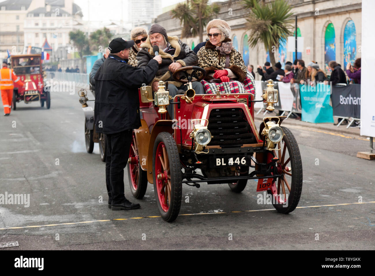 Mr Raymond Ingram, being interviewed,  after successfully completing the 2018 London to Brighton Veteran Car Run, in a 1901 Durkopp - Stock Image