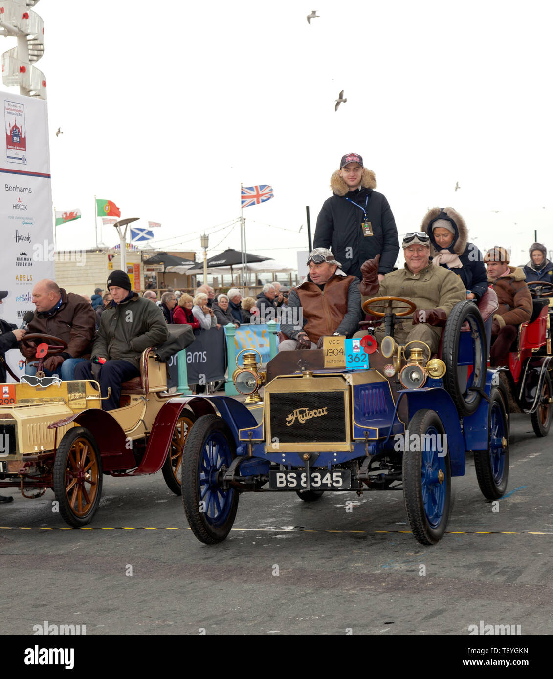 Dr Alexander Schroeder-Frerkes driving his 1901 Autocar, across the finishing line of the 2018 London to Brighton Veteran Car Run - Stock Image
