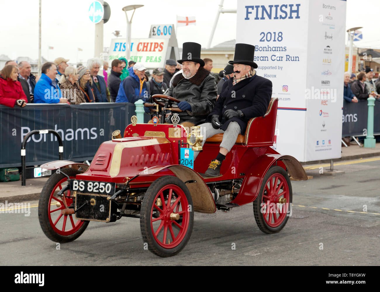 Mr Christopher Atkinson, driving his Maroon, 1903, De Dion Bouton, across the finish line, in Madeira Drive, at the end of the 2018 London to Brighton Veteran Car Run - Stock Image