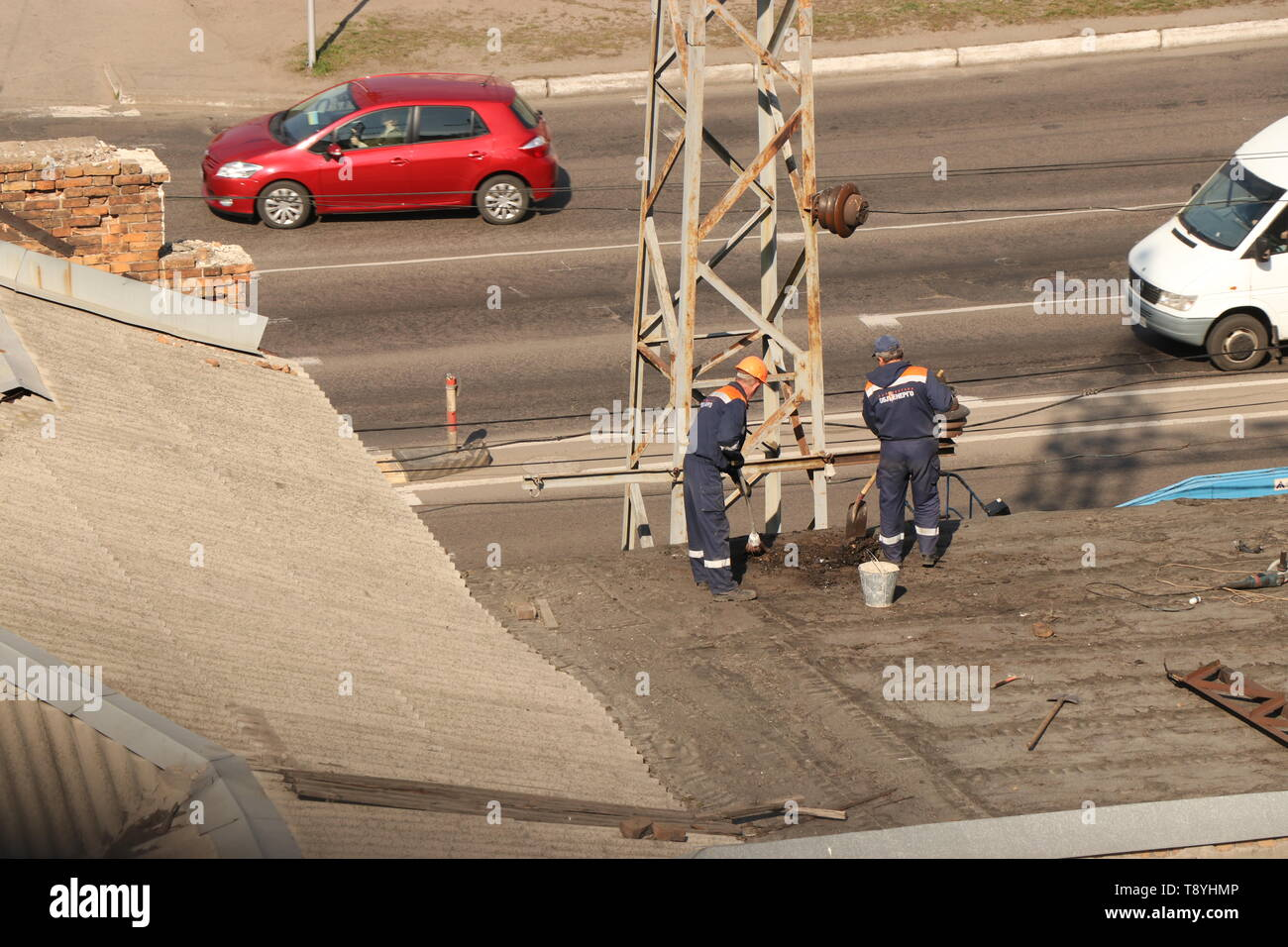 Kremenchug, Poltava region, Ukraine, April 9, 2019, cleaning the roof of the building from debris, repair of the old roof - Stock Image