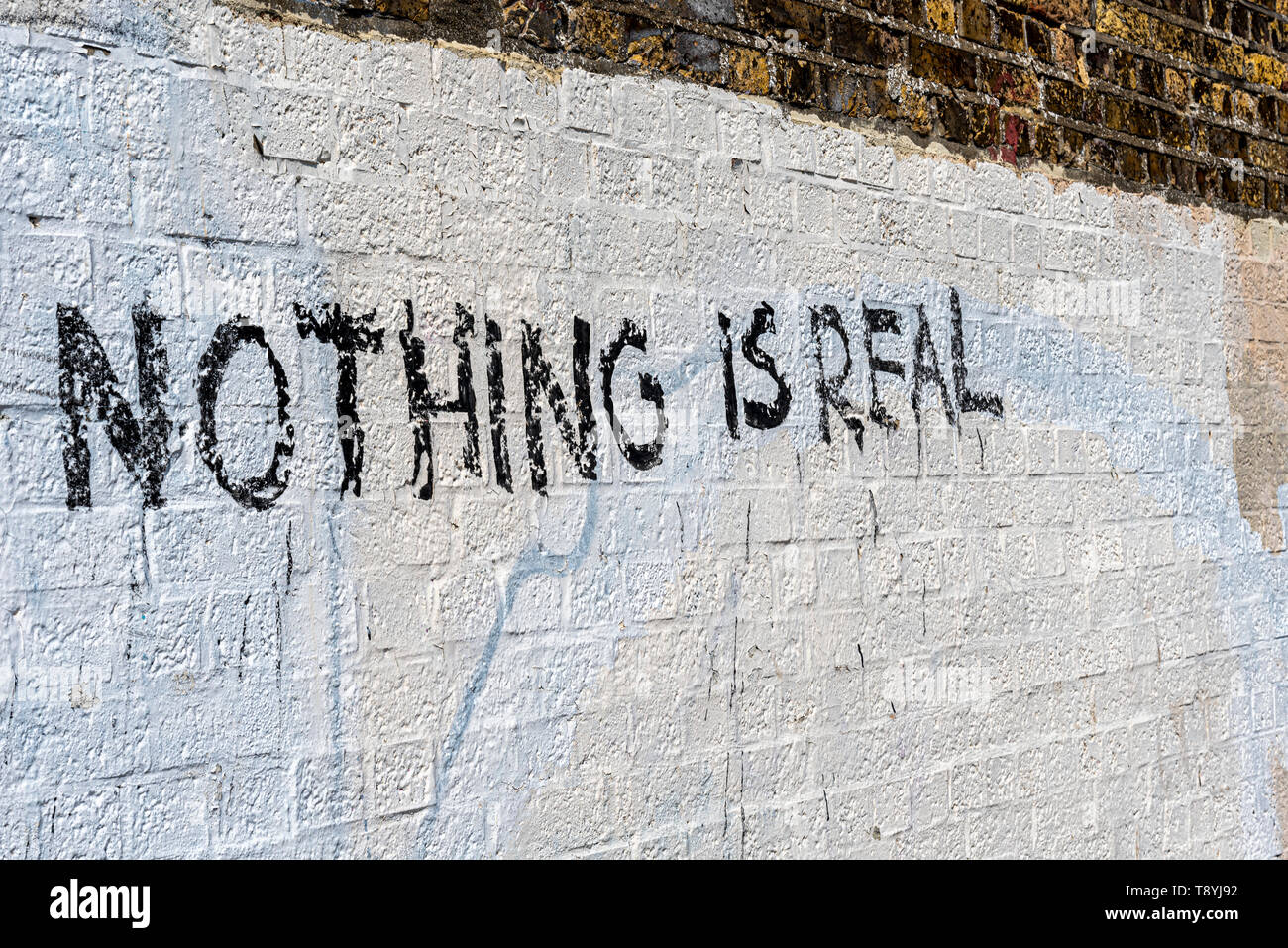 Nothing is real. Graffiti on the wall of Chalkwell railway station on Chalkwell beach, Essex, UK - Stock Image