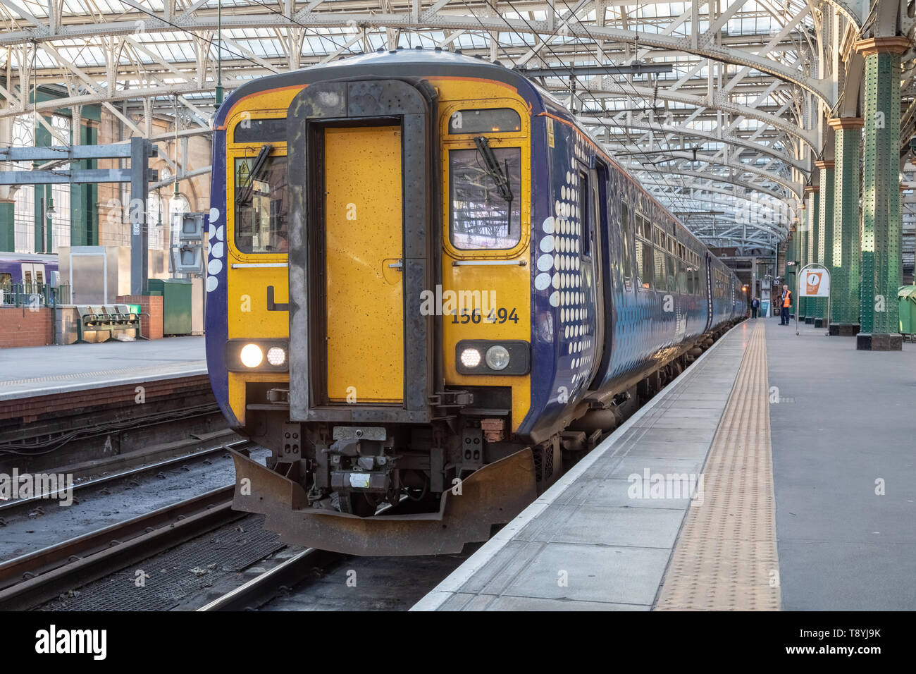 A Scotrail Class 156 diesel multiple unit train sits at platform 10 of Glasgow Central Station. - Stock Image