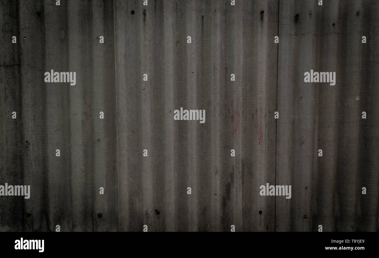 Texture of old gray concrete wall with quilting handprints and bolts. With space for text. Wallpaper for design - Stock Image