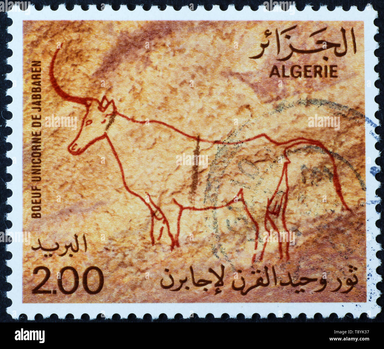 Prehistoric depictions of antelope on algerian postage stamp - Stock Image