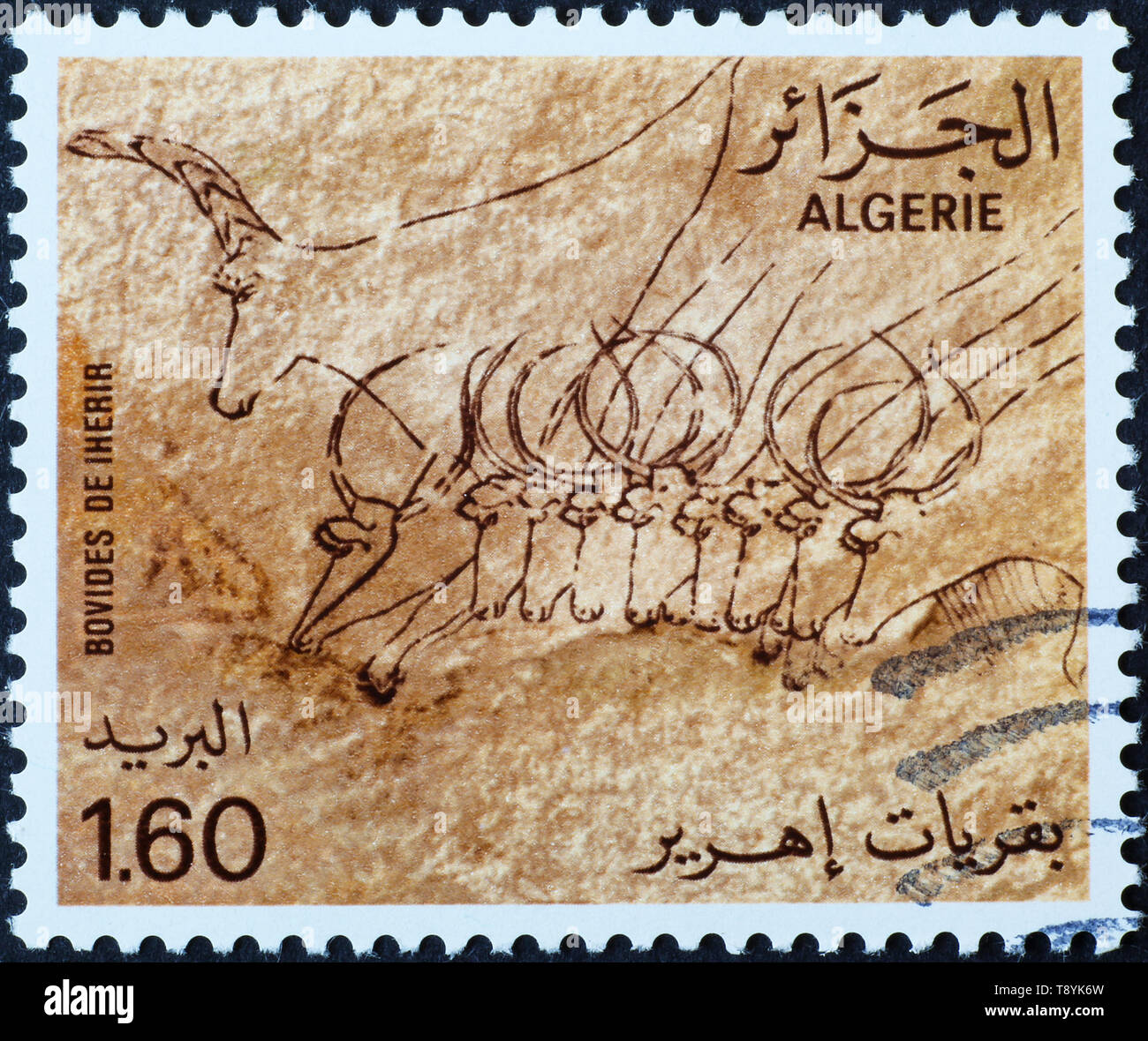 Prehistoric depictions of antelopes on algerian postage stamp - Stock Image