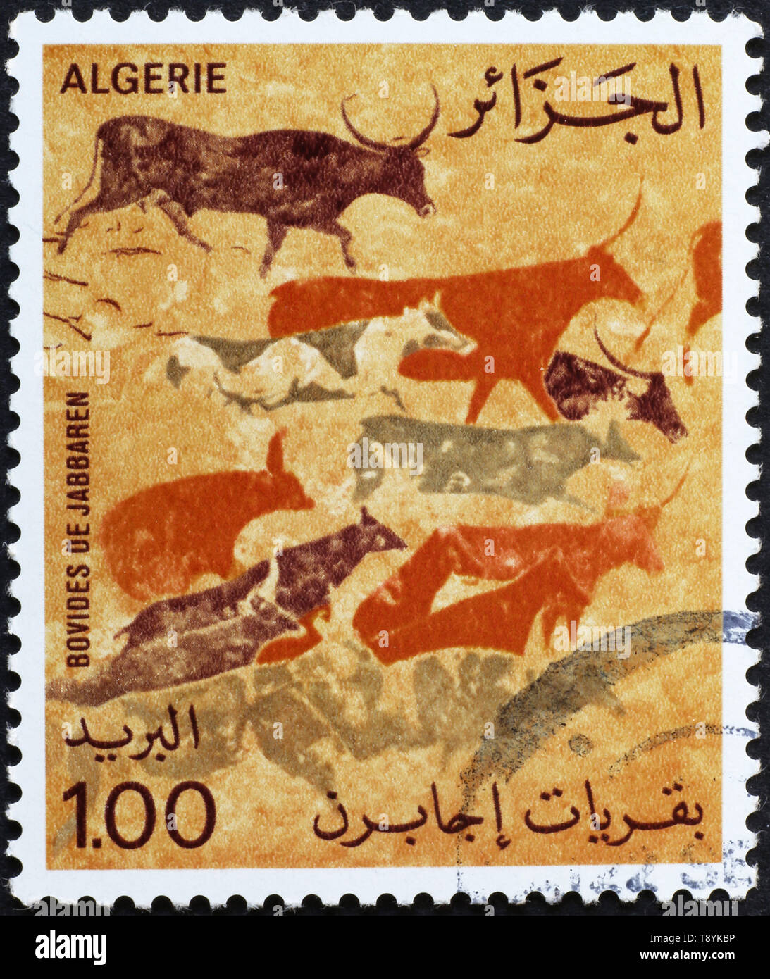 Prehistoric depictions on algerian postage stamp - Stock Image