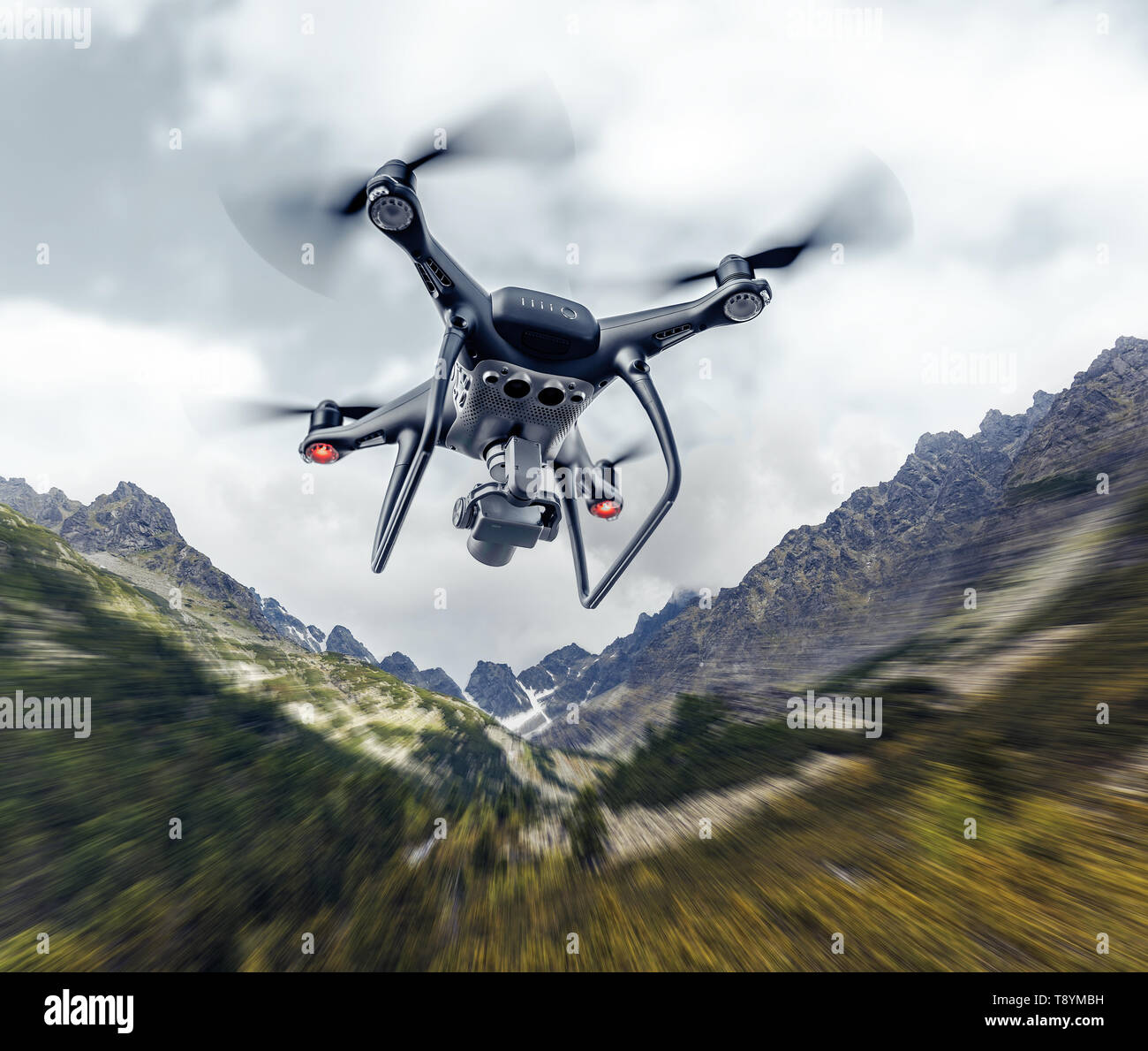 Drone flies in the mountains. - Stock Image