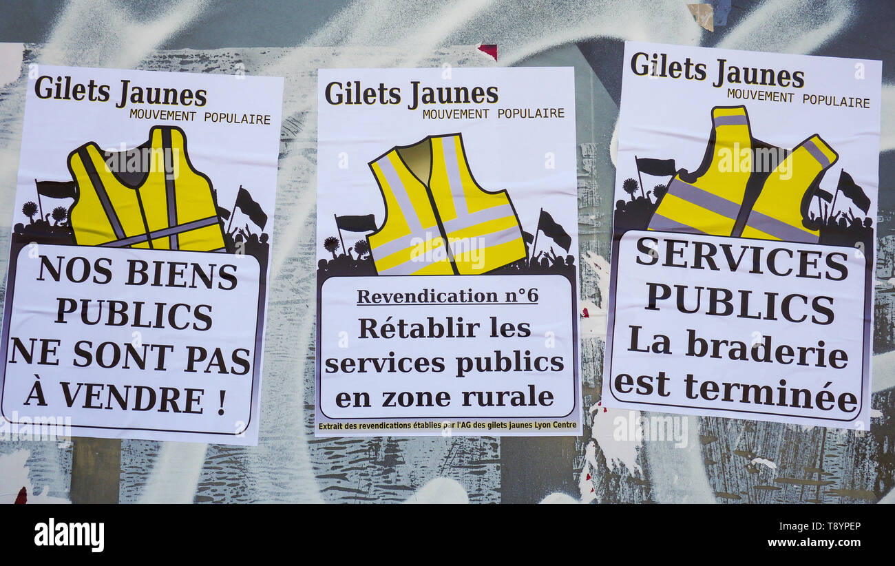 Political posters, Yellow Jackets movement, Lyon, France Stock Photo