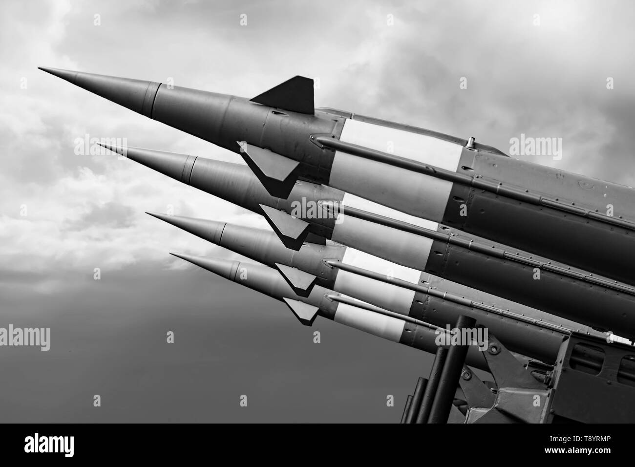 Balistic Rockets War Background. Nuclear Missiles With Warhead Aimed at Gloomy Sky. - Stock Image
