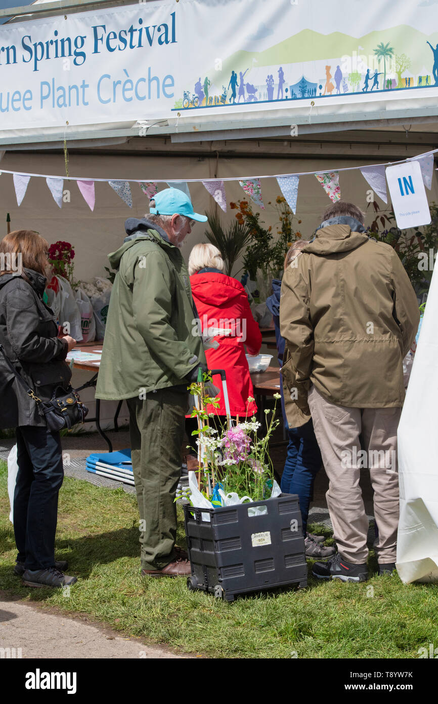 People collecting plants at the floral marquee plant creche, RHS Malvern spring show 2019. Three Counties Showground, Malvern, Worcestershire, UK - Stock Image