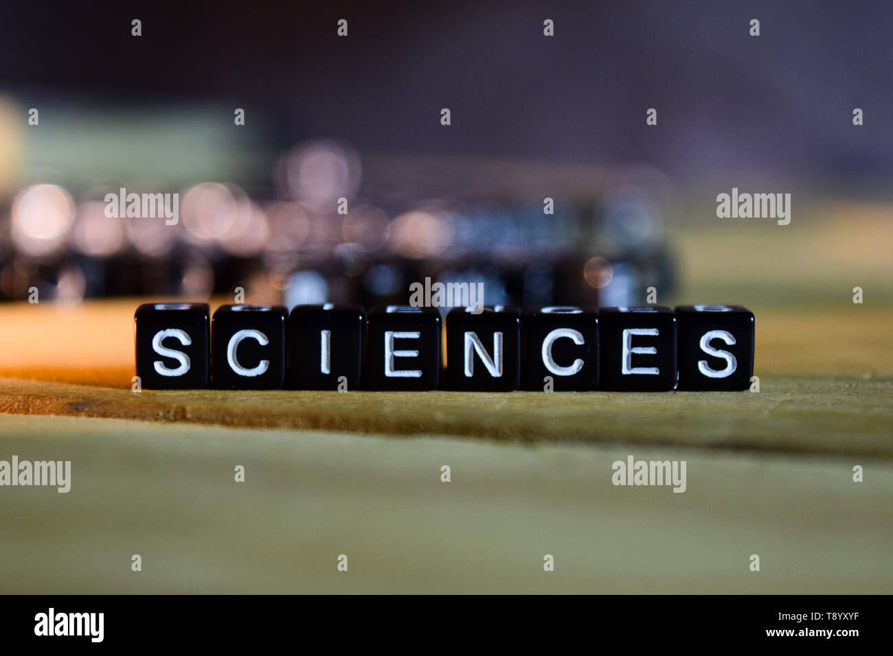 SCIENCES concept wooden blocks on the table. With personal development, education and motivation concept on blurred background Stock Photo