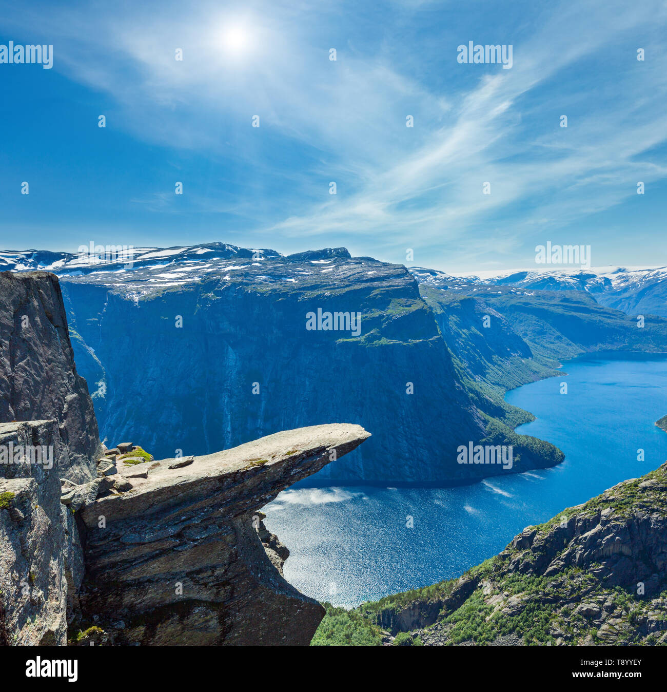 The summer sunshiny view of Trolltunga (famous The Troll's tongue Norvegian destination) and Ringedalsvatnet lake in Odda, Roldal, Norway. - Stock Image