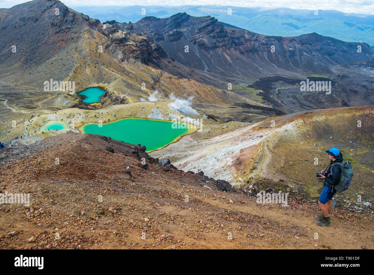 View of Emerald lakes from Tongariro Alpine Crossing hike with clouds above, North Island, New Zealand. - Stock Image
