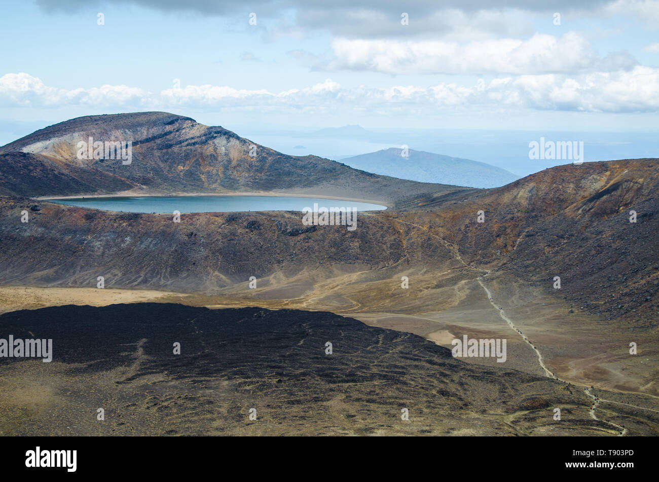 View of Blue lake from Tongariro Alpine Crossing hike with clouds above, North Island, New Zealand. - Stock Image