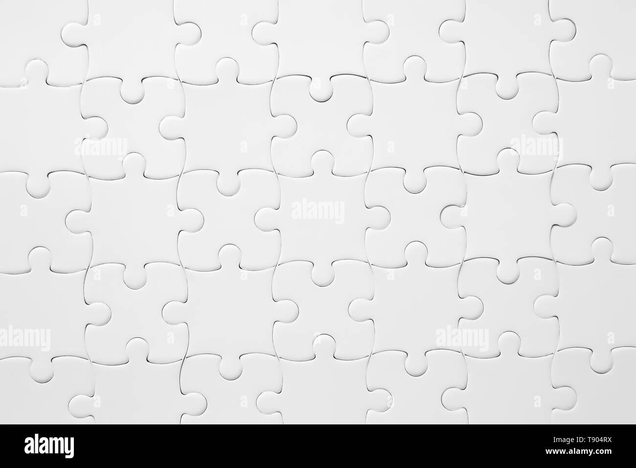 Texture of assembled puzzle as background - Stock Image