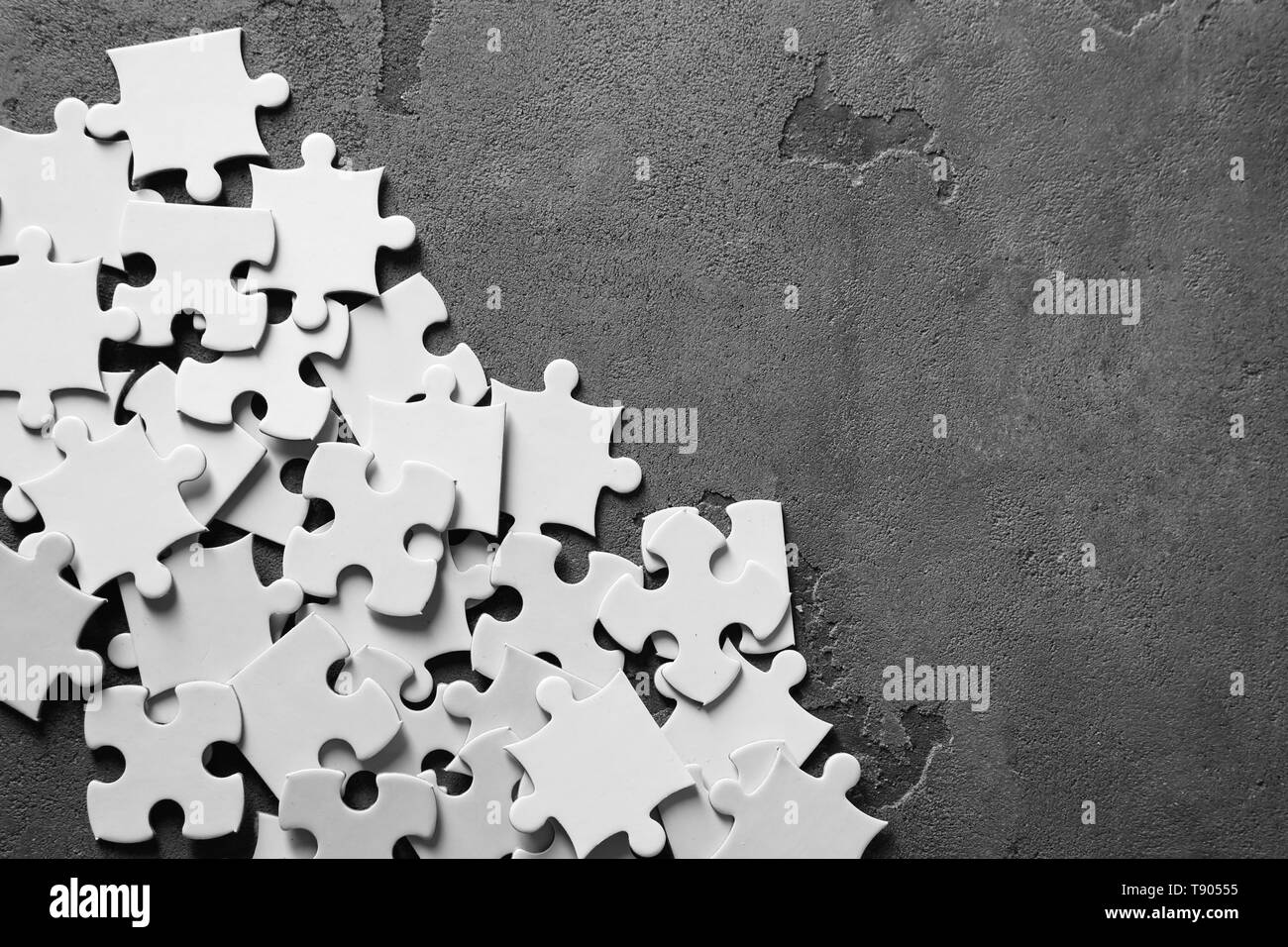 Pieces of jigsaw puzzle on grey background - Stock Image