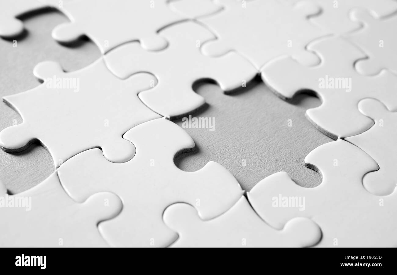 Incomplete jigsaw puzzle on light background, closeup - Stock Image