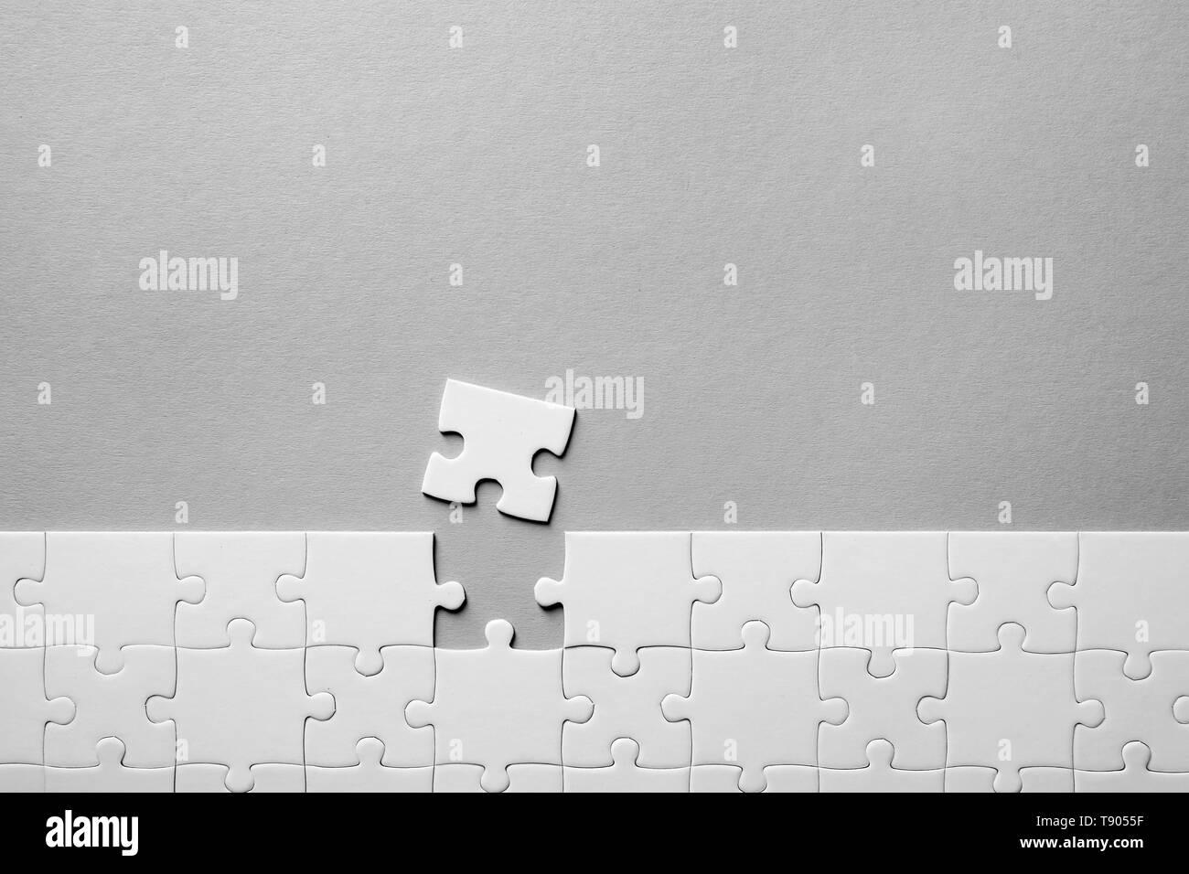 Jigsaw puzzle on light background - Stock Image