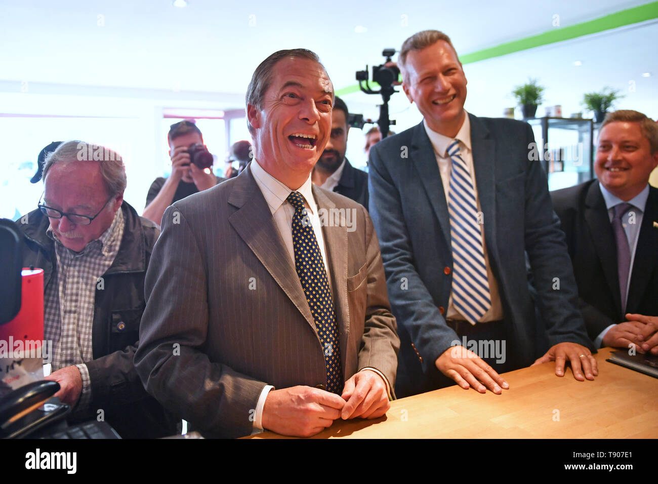 Brexit Party leader Nigel Farage visits a vape shop with the party's lead candidate in Wales, Nathan Gill, during a walkabout in Merthyr Tydfil. - Stock Image