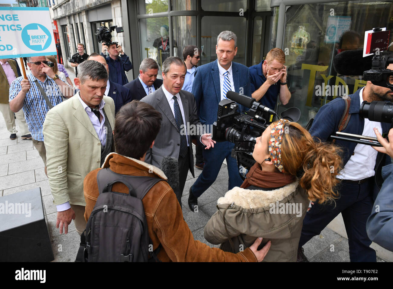 Brexit Party leader Nigel Farage with the party's lead candidate in Wales, Nathan Gill, during a walkabout in Merthyr Tydfil. Stock Photo