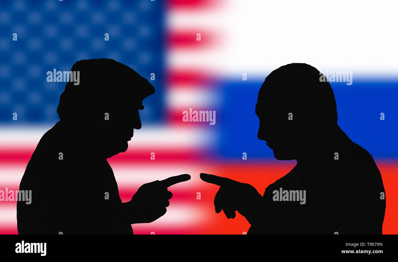 Silhouettes to represent the USA President, Donald Trump, and the Russian President, Vladimir Putin, facing each other pointing, as if arguing. Stock Photo