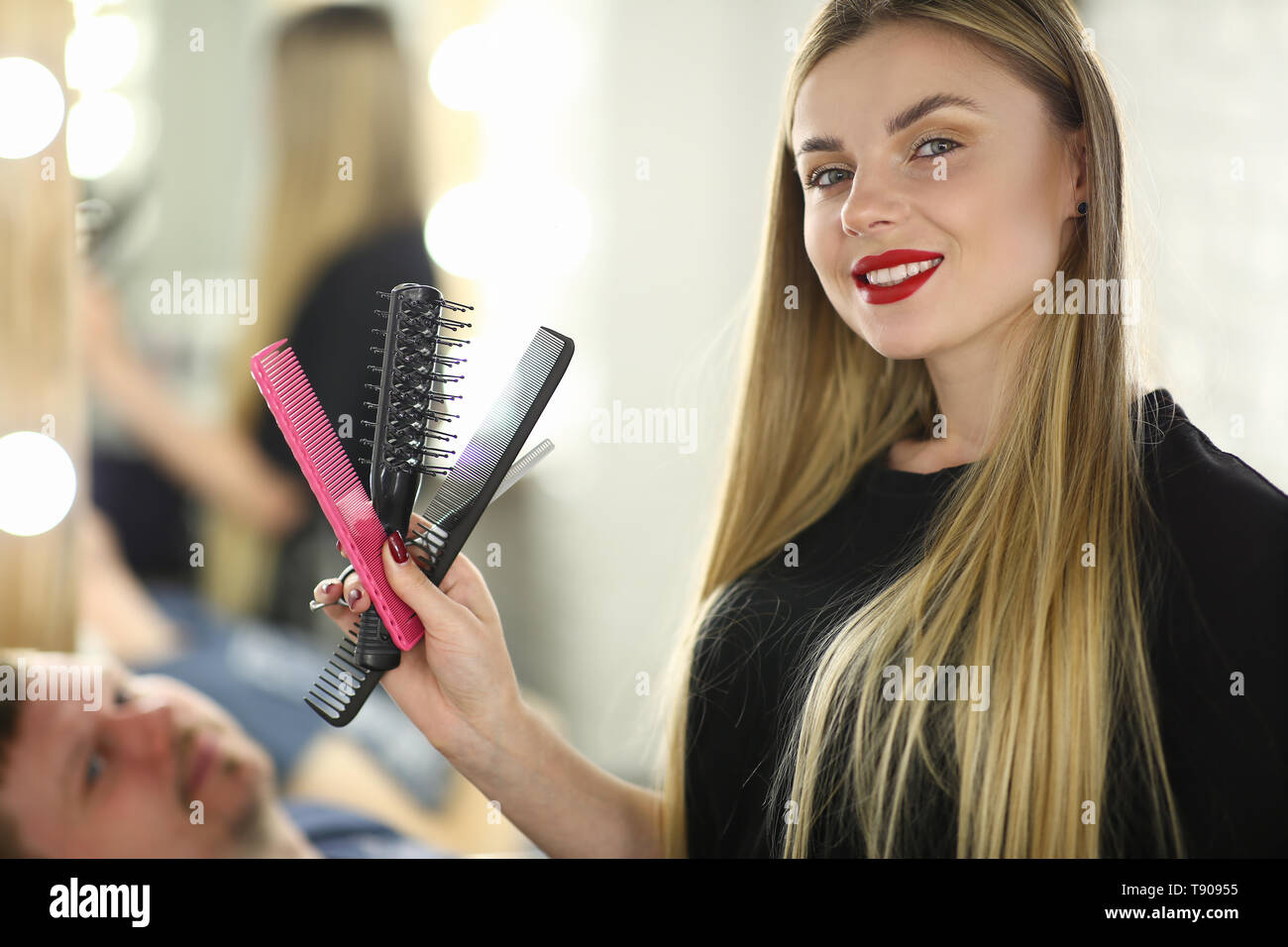 Professional Female Hairstylist with Hairbrush - Stock Image