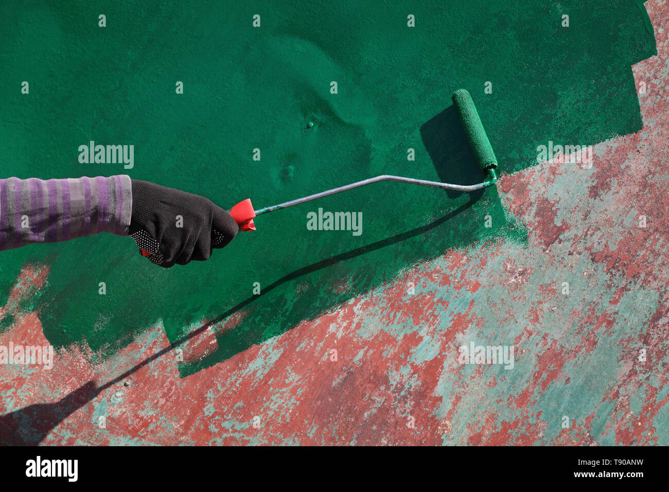 Female Worker Painting Old Metal Roof Plate To Green Color