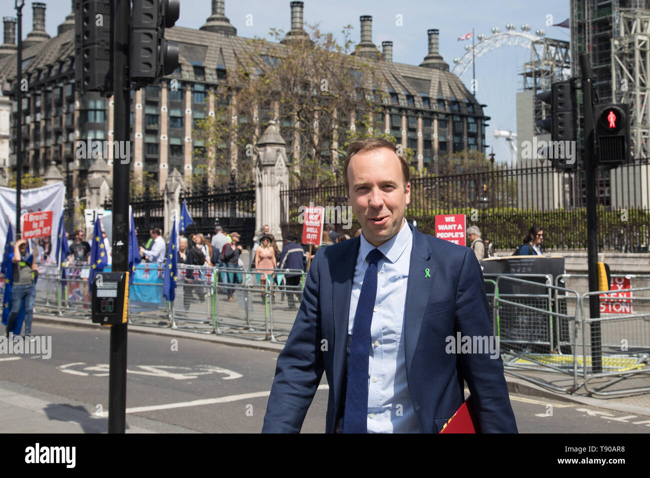 London, UK. 15 May 2019. Pro-Brexit protesters chase after Matt Hancock, Secretary of State for Health and Social Care as he leaves the Commons, Westminster. The Prime Minister faces Question Time in the Commons. - Stock Image