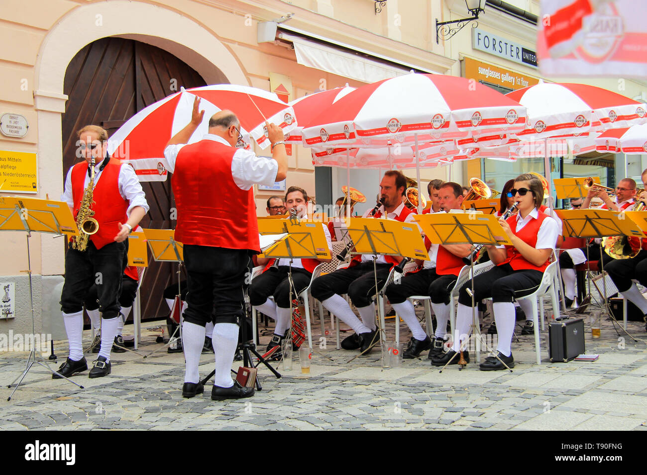Melk, Austria, 09 07 2018. The Amateur Symphony Orchestra of Melk residents in uniform in the colors of the Austrian flag performs for tourists. - Stock Image