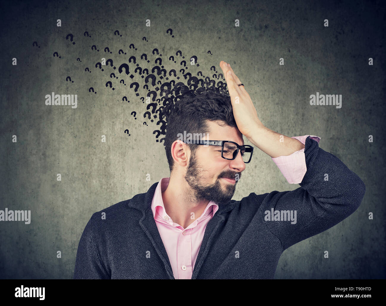 Man with worried stressed face expression and many questions - Stock Image