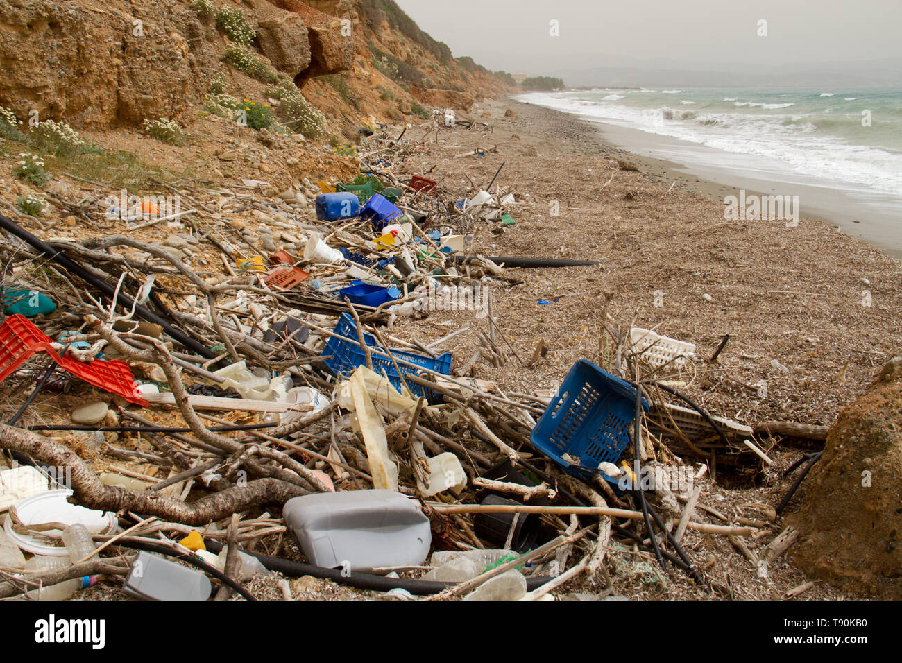 Plastic soup; lots of plastic trash washed ashore on the beach of Crete - Stock Image