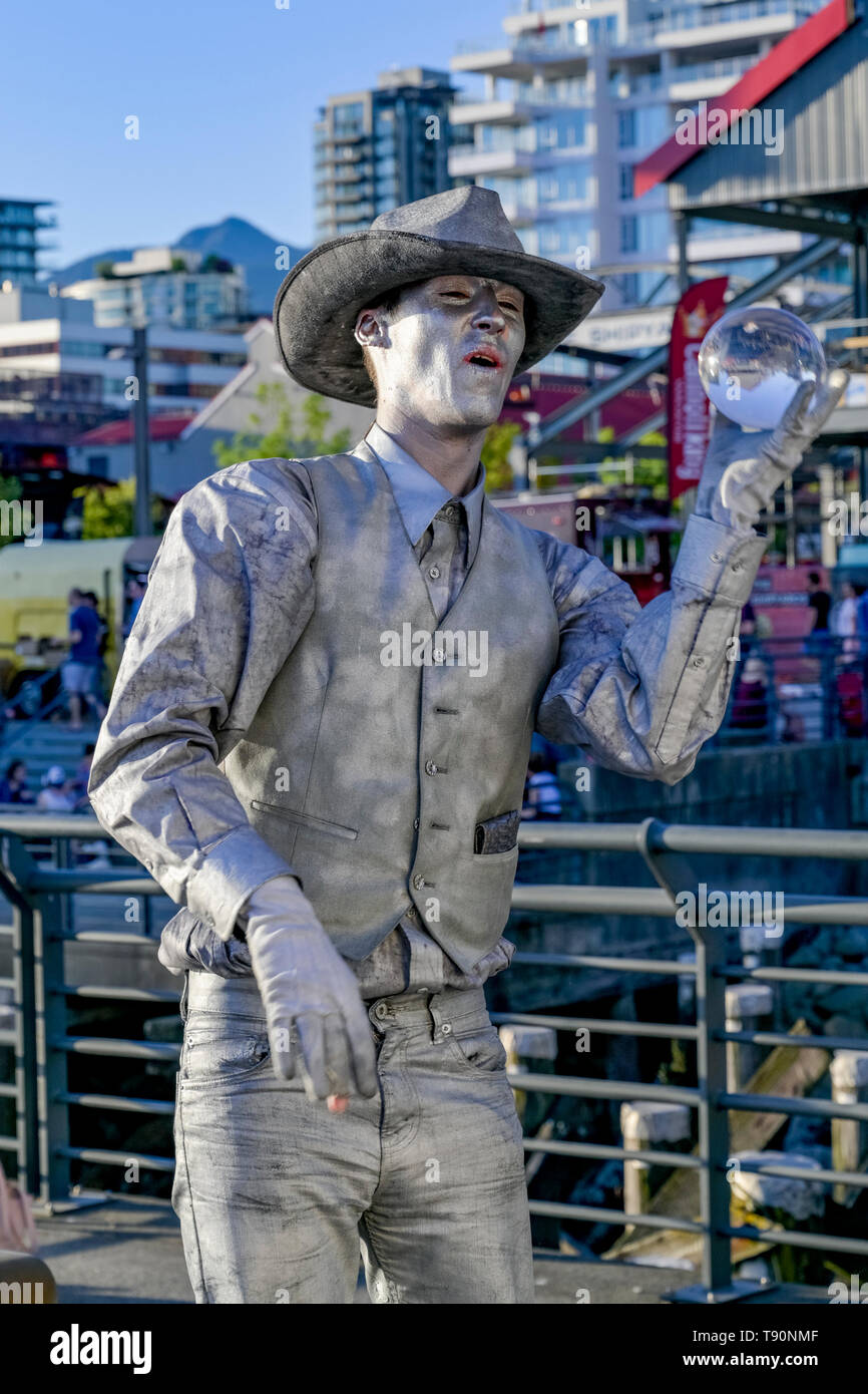 Mime, human statue, street performer, Lonsdale Quay, North Vancouver, British Columbia, Canada - Stock Image