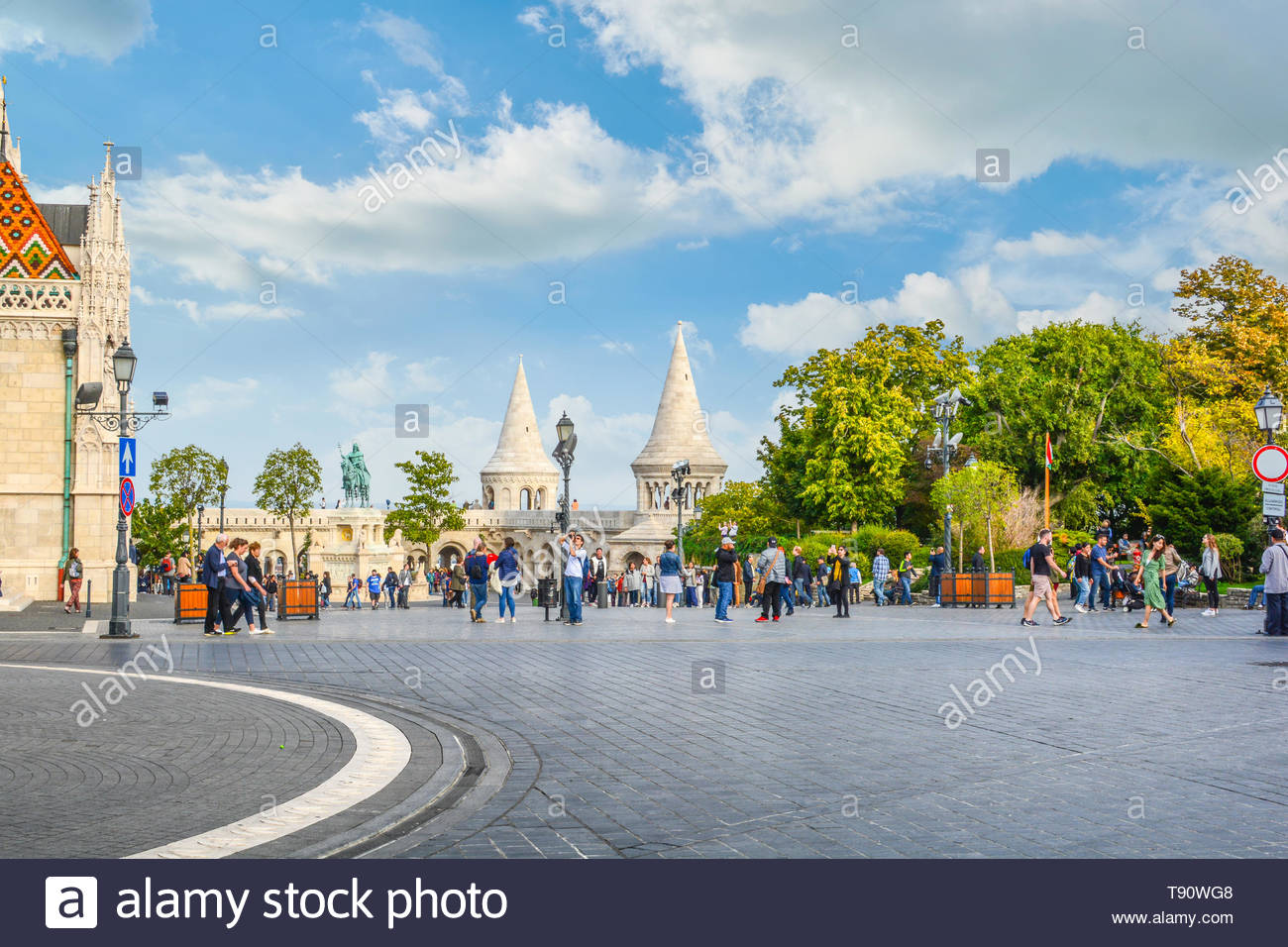 Matthias Square with the Matthias Church and the Fisherman's Bastion with tourists enjoying the sunny day in Budapest Hungary Stock Photo