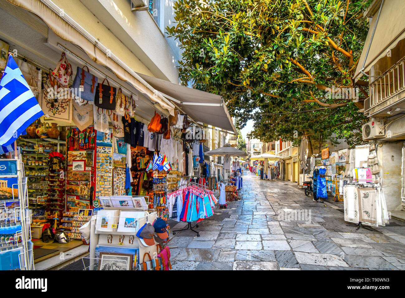 A typical tourist street and neighborhood in the Plaka District of Athens, Greece, with cafes, souvenirs and markets Stock Photo