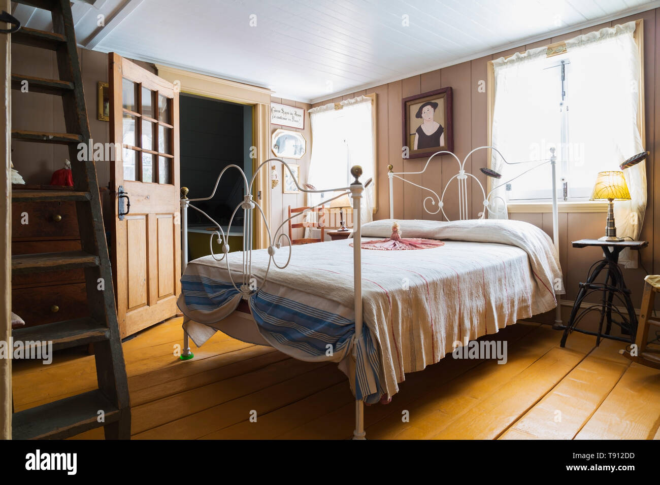 Double Bed With White Painted Wrought Iron Headboard And Footboard With Brass Ball Finials In Upstairs