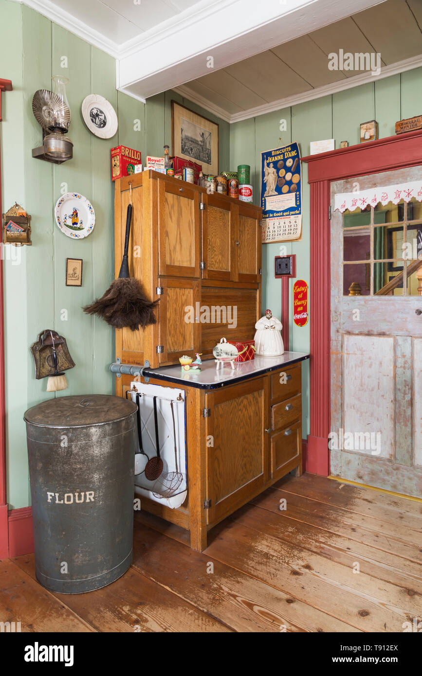 Antique Wooden Buffet With Vintage Cooking Products And