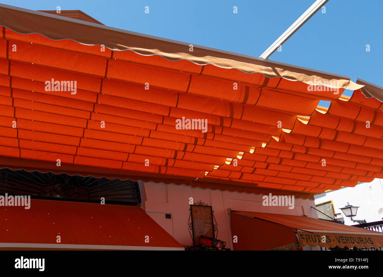 Awning for shade in a produce market on a hot summer day in Seville - Stock Image