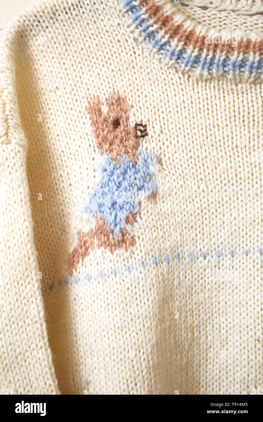 A Child's Peter Rabbit Knitted Wool Jumper Stock Photo Alamy
