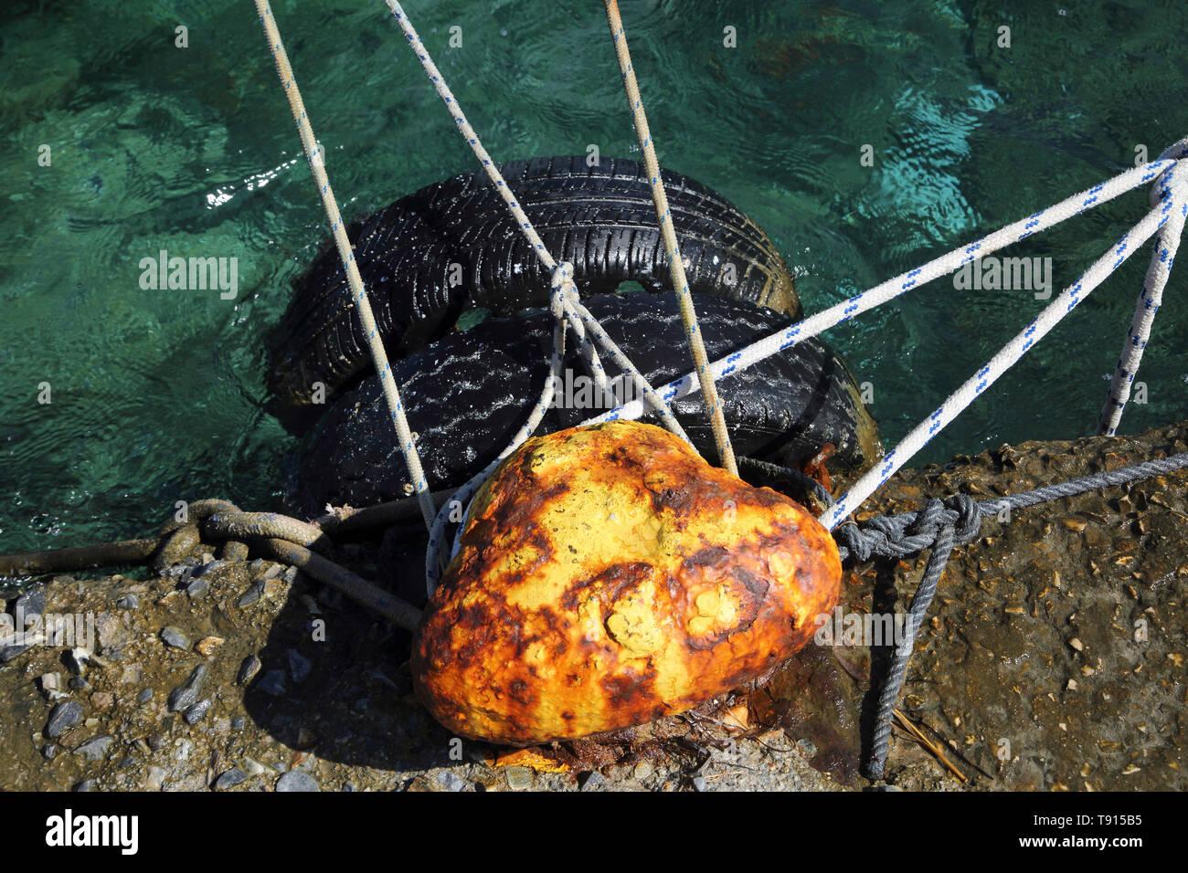 Vourkari Kea Island Greece Boats tied off to Mooring Bollard - Stock Image