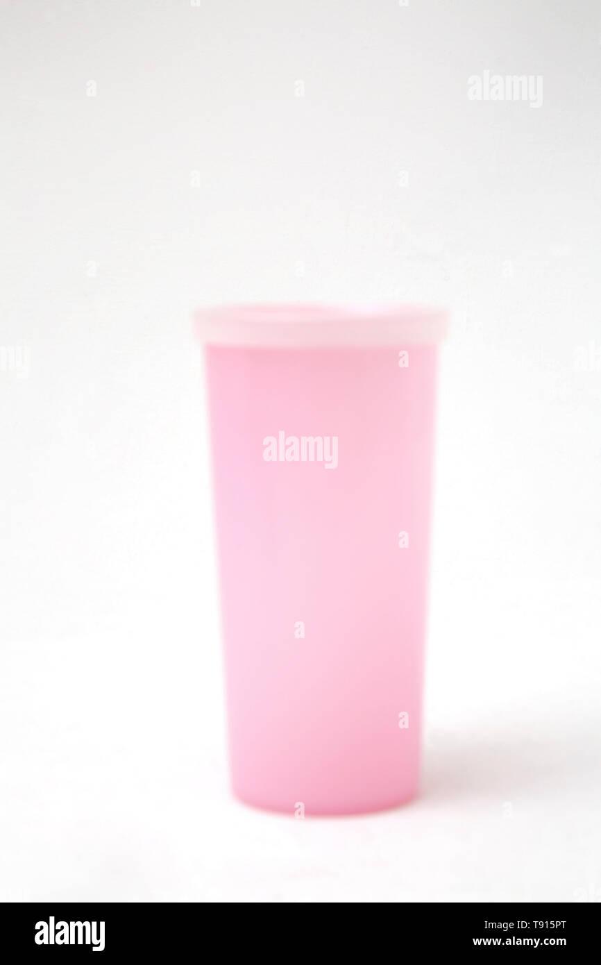 Vintage Pink Tupperware Beaker with Lid - Stock Image