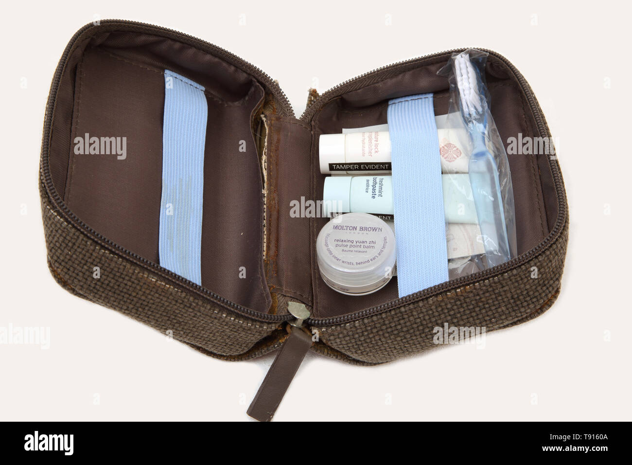 Molton Brown Travel Toiletry set - Moisturiser, Toothpaste, Toothbrush and Yuan Zhi Pulse Point Balm - Stock Image
