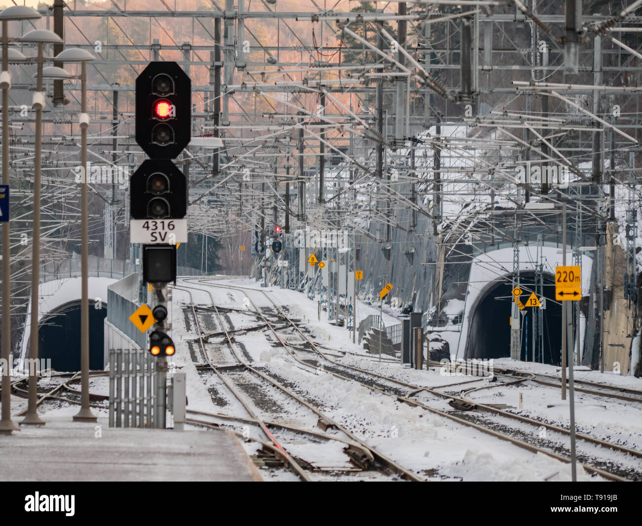 Railway lines and complicated grid of catenary power cables at the railway station in Sandvika, a suburb west of Oslo in Norway. Stock Photo