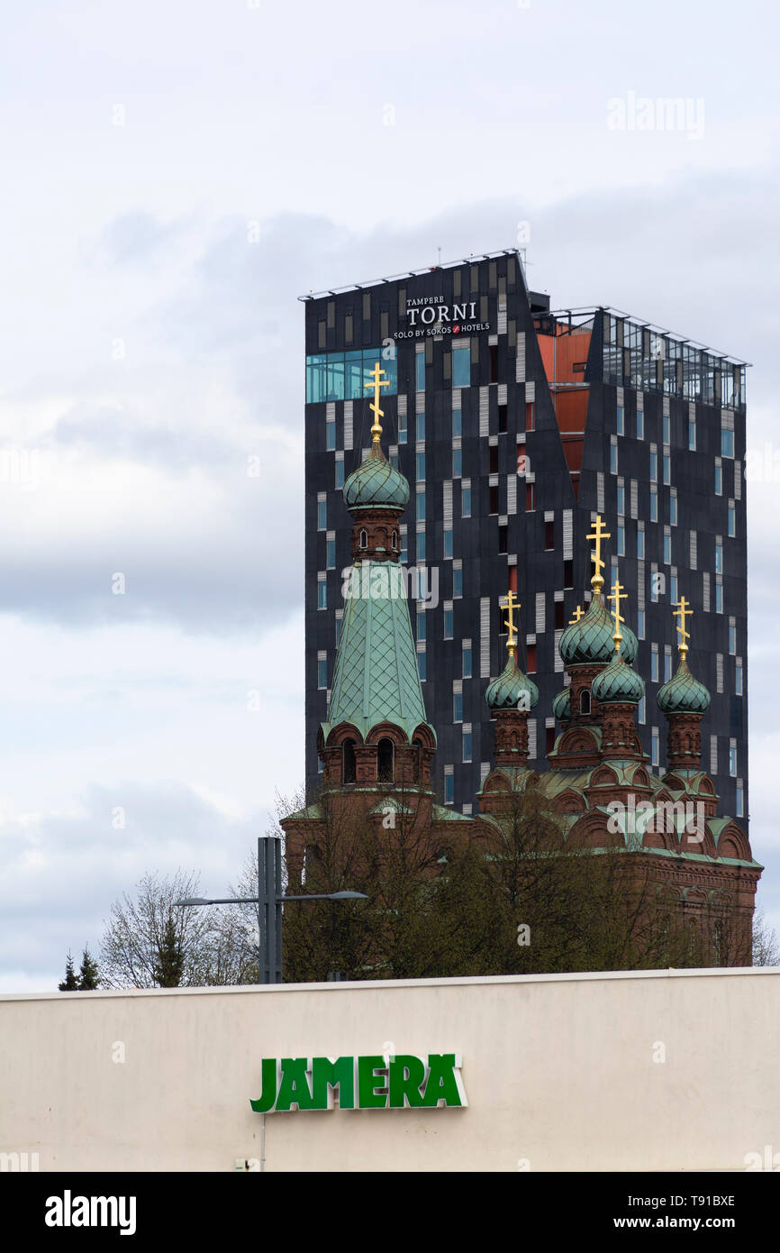 The Orthodox church of St. Alexander Nevsky and St. Nicholaos and Torni Hotel in Tampere Finland - Stock Image